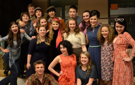 The cast of Shakespeare's Love's Labor's Lost gathered after an hour of backstage preparations for a quick photo before their opening night performance. The cast was made up primarily of juniors and seniors. The show ran March 7-9 and was reimagined in the 1960s with females taking the originally male lead roles and males taking the originally female roles.