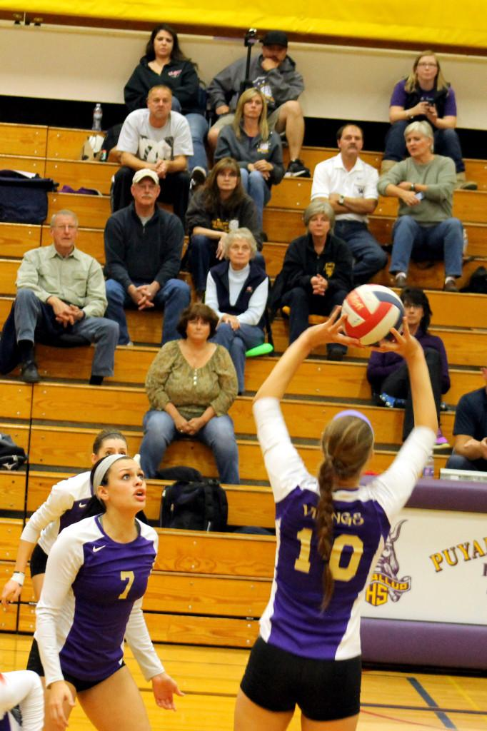 Junior Addie Picha sets the ball to Junior Gabby Gill on Oct. 18.