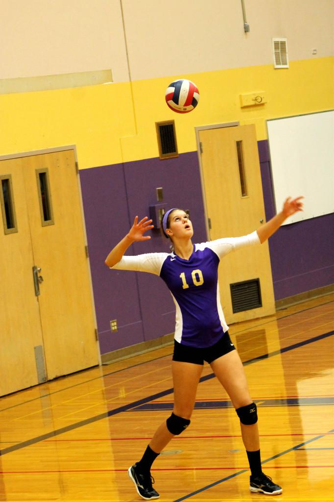 Junior Addie Picha serves the ball to Curtis on Oct. 18.