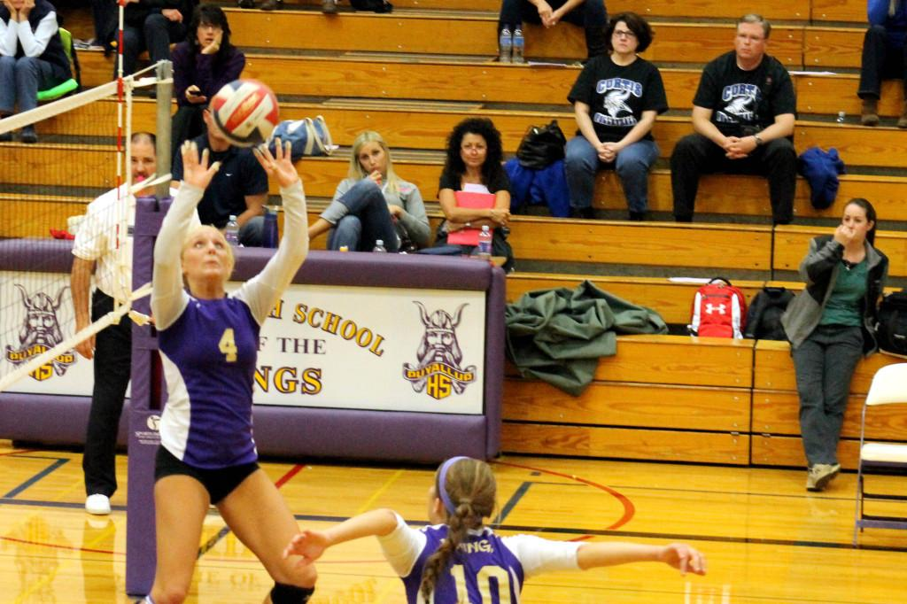 Senior Braylie Jeffers sets the ball as Junior Addie Picha goes up for a hit against Curtis on Oct. 18.