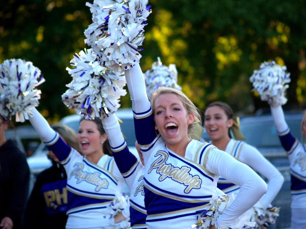 Senior cheer captain Paige Wolter leads cheers alongside senior Caroline Wright and junior Sierra Molmen. Cheer supports not only football and basketball, but the other fall and winter sports as well.