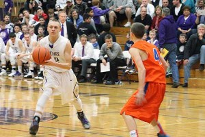 Sophomore Tyler Torgerson goes to pass the ball in their game against Graham- Kapowsin Jan. 24.
