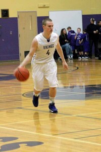 Junior Brady Winter dribbles the ball in the game against Graham- Kapowsin Jan. 24.