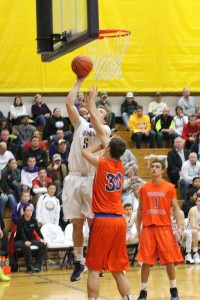 Senior DJ Winter goes up for a shot in the game against Graham- Kapowasin Jan. 24.