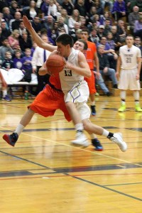 Junior Ross Dombrowski rushes down the court preparing to take a shot Jan. 24 against Graham- Kapowsin.
