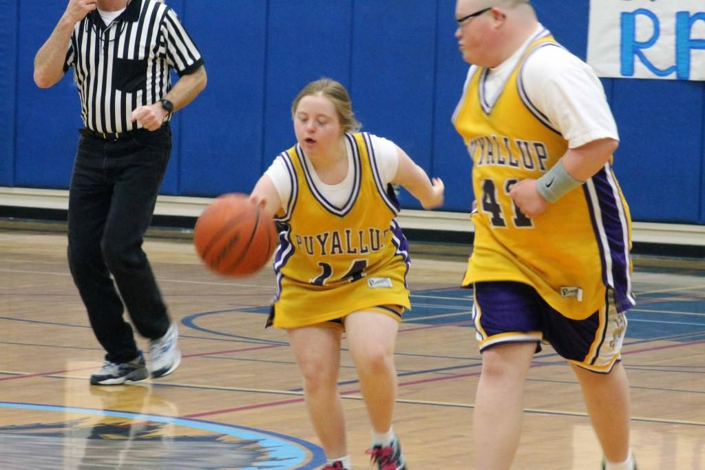 Junior Lindsay Rolf dribbles the ball down the court in the annual Special Olympics basketball game against rogers Jan. 27.