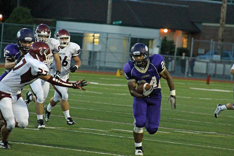 Junior Michael Fuller passes by the Falcon Defense.
