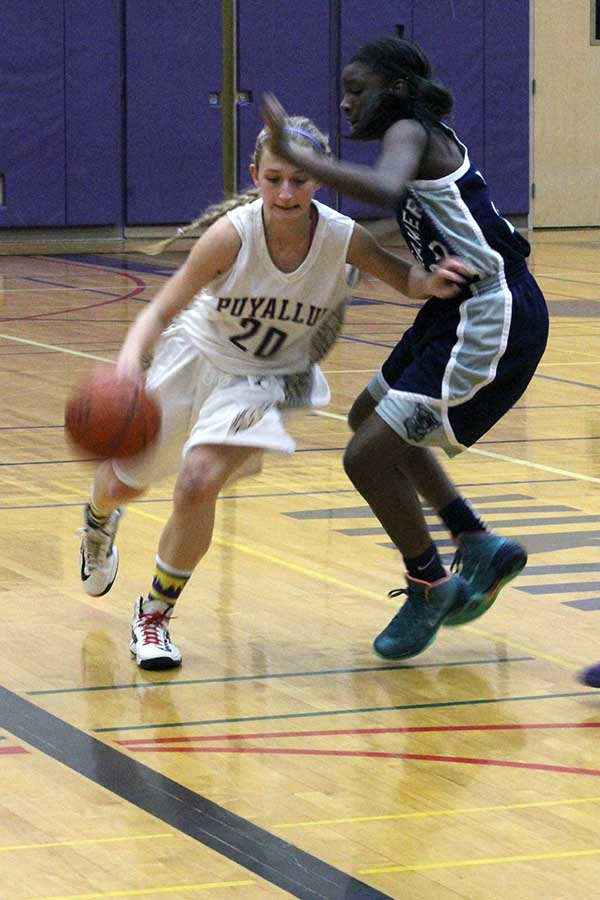 Junior Sarah Steimle dribbles the ball around a Todd Beamer defender in their game at home, Jan. 7. The Lady Vikings lost 56-39. Steimle scored 3-points in the game.
