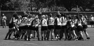 Junior Kassandra Reynolds, who sports the number 22 on the back of her jersey, heads into a huddle with her team, the Kent Crusaders, before a game.
