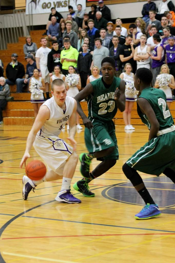 Junior Brady Winter dribbles the ball down the court.