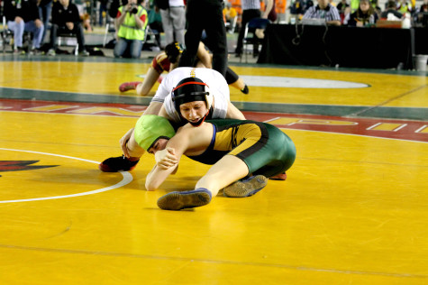 Junior Haley Franich takes down her opponent in her second round match of the Washington State Wrestling Tournament Feb. 21 at the Tacoma Dome.