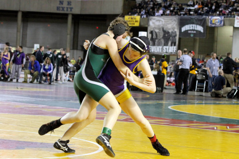 Sophomore Jordyn Bartelson goes to trip her opponent and take her down in the Washington State Wrestling Tournament Feb. 21 at the Tacoma Dome.