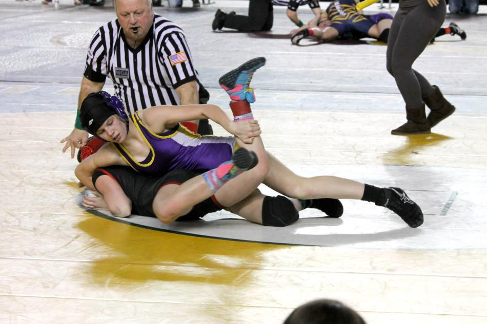 Freshman Brooklyn Bartelson works her opponent in pursuit of a pin in the Washington State Wrestling Tournament Feb. 22 in the Tacoma Dome.