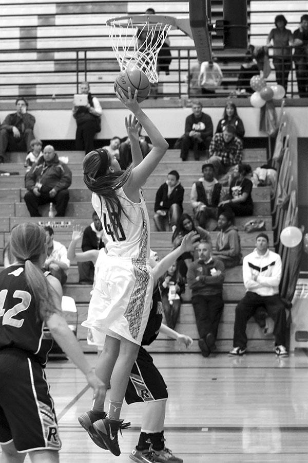 Junior Addison Picha goes up for a basket against Rogers High School Feb. 6.