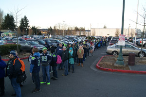 Not a short line, fans stood in brisk February weather Wednesday morning, attempting to make it up to Seattle for the Seahawk celebration parade, Feb. 5.