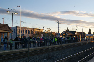 Masses of Seahawk fans gather at the Puyallup SoundTransit station early Wednesday morning wearing their blue and green. Approximately 700,000 fans gathered in Seattle for the celebratory parade to honor the Superbowl champions. Lines for tickets for the train stretched around both sides of the tracks.