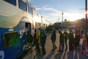 Lines of Seahawk fans board SoundTransit trains at the Puyallup train station early Wednesday morning, heading to the parade to celebrate the Seahawk Superbowl XXXXVIII, Feb. 2.