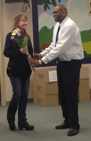 Jason Smith announces CIS Teacher of the Year, Pam Reichel, at a staff meeting March 25 in the library.