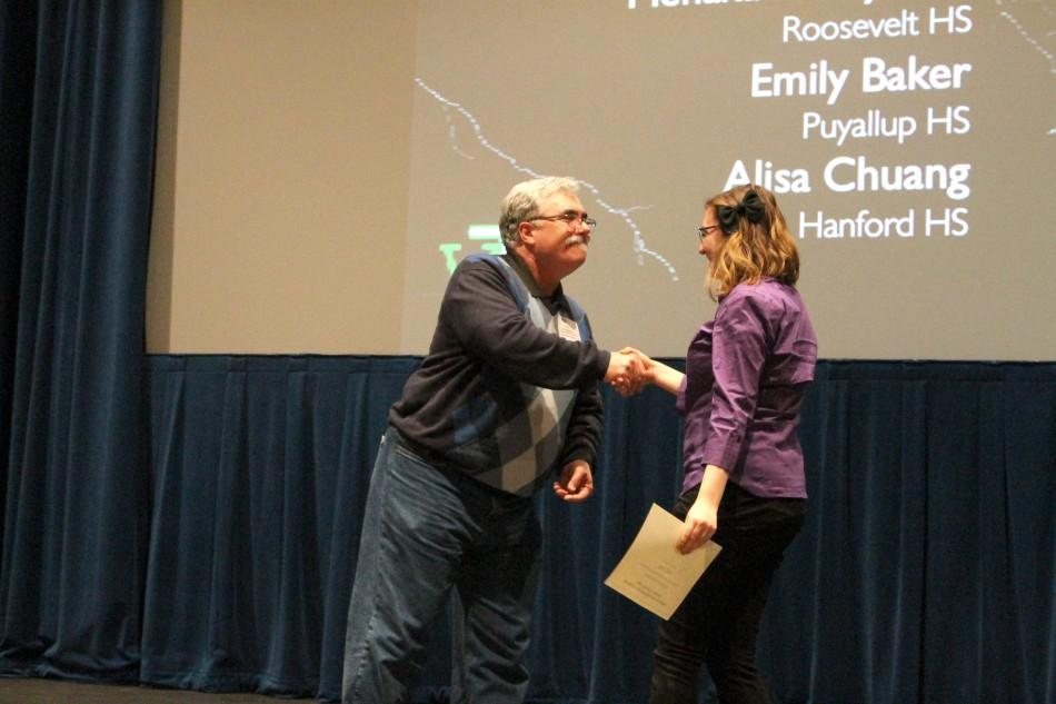 Sophomore Emily Baker receives an honorable mention in the features write-off contest at the WJEA state convention March 15 at Shorewood High School.