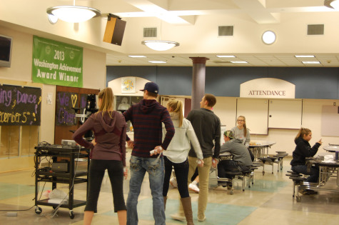 """As a part of DECA week, DECA held """"Just Dance"""" night Nov. 17. From left DECA students Noah Fenz, Carle Utti, Libby Gabriel, and Nick Papen play """"Just Dance"""" on the wii. The purpose of DECA week is to acknowledge DECA because in Carle Utti opinion, """"DECA is life."""""""