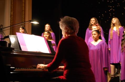 Dr. Merilyn Jacobson accompanies the chorus on the piano.