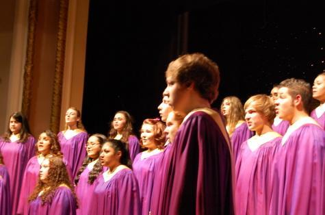 "The chorus sings ""Candlelight Carol,"" a modern carol written by English Composer John Rutter."