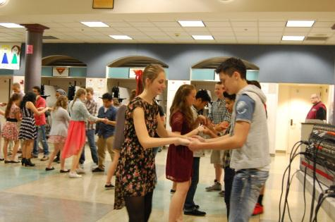 Students each grab a partner and try out the newly taught moves.