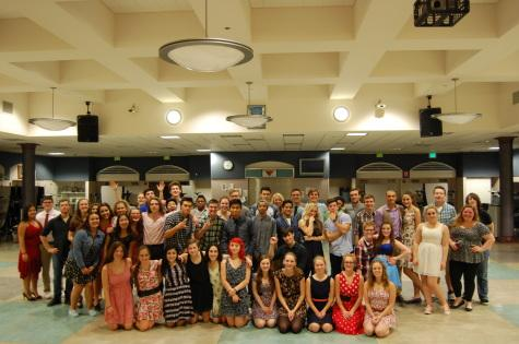 The students gather for a group photo at the end of the dance.
