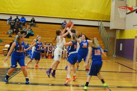 Junior Hannah DeWitt shoots the ball.