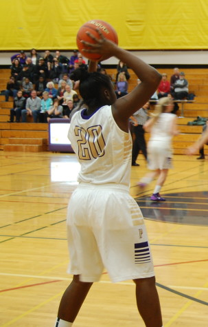 Sophomore Alexius Foster passes the ball to a teammate.