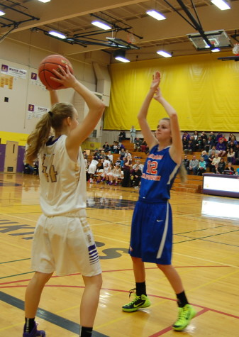 Junior Kylie Myers throws the ball back in bounds.
