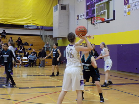 Junior Hannah DeWitt prepares to pass the ball to a teammate. Puyallup High School girls varsity basketball defeated Spanaway Lake High School Jan. 13. The final score was 57-41.