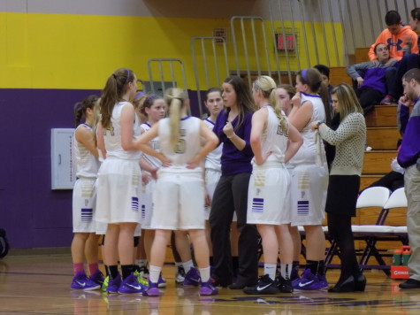 Coach Ainslie gives the team a quick pep-talk during a timeout. Puyallup High School girls varsity basketball defeated Spanaway Lake High School Jan. 13. The final score was 57-41.