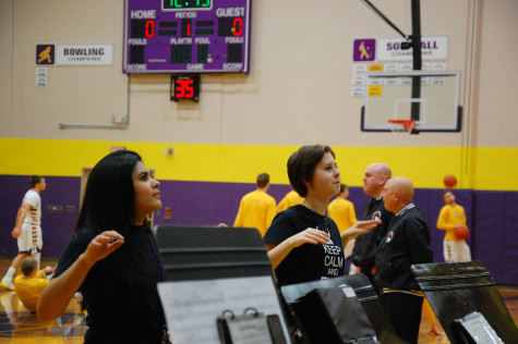 Senior drum leaders Tiffany Nomakchteinsky and Maddy Lucas lead the band prior to the start of the game. The boys basketball team lost to Curtis High School Jan. 20 with a score of 68-75 after going into overtime.