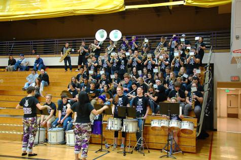 """The band plays """"Louie Louie"""" to entertain the crowd as players warm up on the court. The boys basketball team lost to Curtis High School Jan. 20 with a score of 68-75 after going into overtime."""