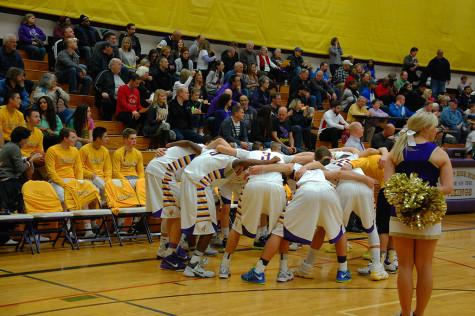 The boys basketball team huddles up in preparation for the game. The boys basketball team lost to Curtis High School Jan. 20 with a score of 68-75 after going into overtime.