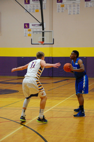 Junior Jaden Vollmen defends a Curtis player. The boys basketball team lost to Curtis High School Jan. 20 with a score of 68-75 after going into overtime.