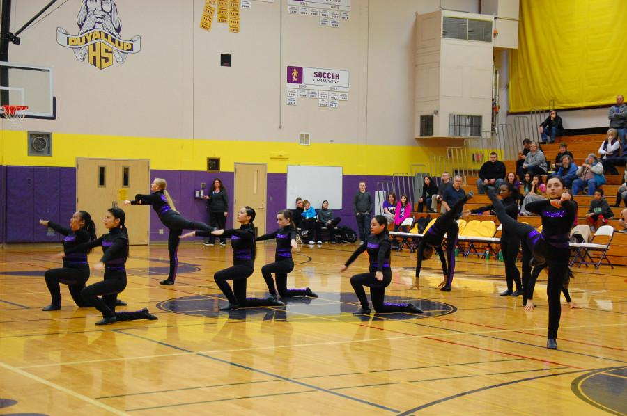 The Dance Team performs at halftime. The boys basketball team lost to Curtis High School Jan. 20 with a score of 68-75 after going into overtime.