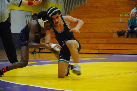 Freshman Jason Walker tries to take his opponent down. The wrestling team won 49-18 against Spanaway Lake High School Jan. 21.