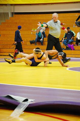 Senior Tyler Grajek attempts to bring his opponent down. The wrestling team won 49-18 against Spanaway Lake High School Jan. 21.