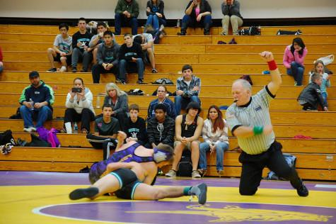 Senior Ryan Colkitt nearly pins his opponent. The wrestling team won 49-18 against Spanaway Lake High School Jan. 21.