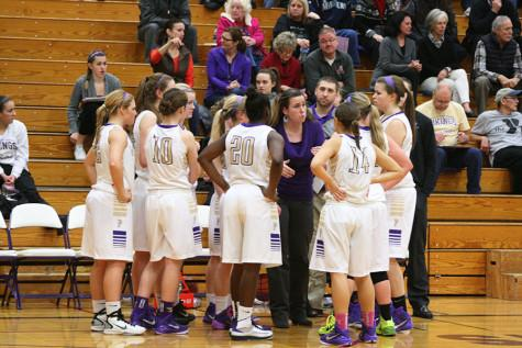Coach Ainslie talks to the team before the game begins.The girls basketball team won against Spanaway Lake High School  Jan. 13 with a score of 57-41.