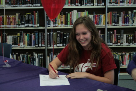 Liz Griffith smiles as she prepares to sign her letter of intent. Griffith will play soccer at Washington State University.