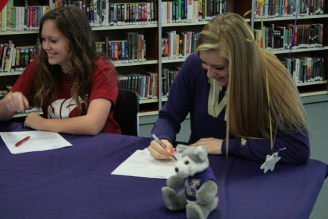 Jessica Udovich begins to sign her letter of intent to University of Washington, where she plans to play soccer.