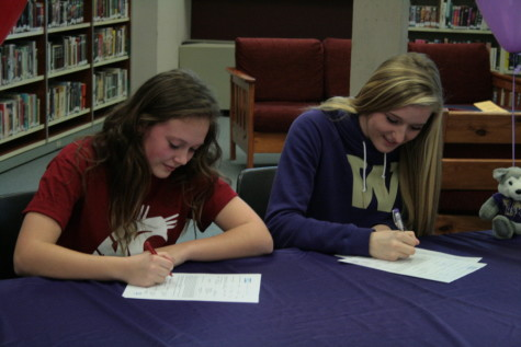 Liz Griffith and Jessica Udovich sign their letters of intent.