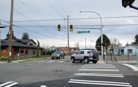 The new spotlight at the intersection of Fifth Street and Seventh Avenue was placed to reduce traffic and promote pedestrian and driver safety.
