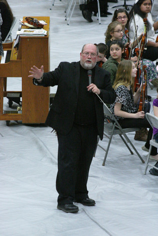 Orchestra director Todd Giltner introduces the first and second year, junior high  and high school orchestra. The Region Three Orchestra Festival was held Feb. 25 in the PHS gym. First and second year orchestra students along with the combined orchestra of Edgemont, Aylen and Kalles performed with the Puyallup High School orchestra.