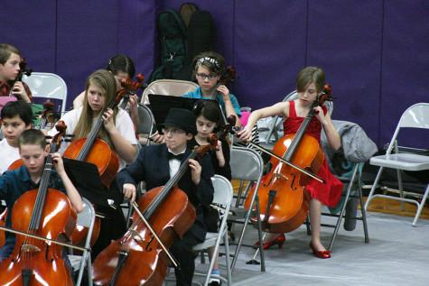 First year cello players perform. The Region Three Orchestra Festival was held Feb. 25 in the PHS gym. First and second year orchestra students along with the combined orchestra of Edgemont, Aylen and Kalles performed with the Puyallup High School orchestra.