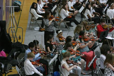"Second year violinists play ""Minature Symphony."" The Region Three Orchestra Festival was held Feb. 25 in the PHS gym. First and second year orchestra students along with the combined orchestra of Edgemont, Aylen and Kalles performed with the Puyallup High School orchestra."