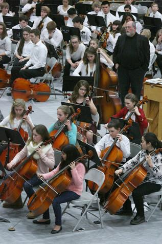 Second year cellists intently focus on their music. The Region Three Orchestra Festival was held Feb. 25 in the PHS gym. First and second year orchestra students along with the combined orchestra of Edgemont, Aylen and Kalles performed with the Puyallup High School orchestra.